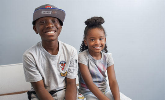 Two smiling African American children