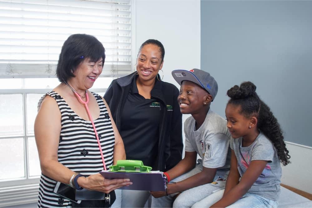Family listens to provider at LifeLong LeNoir Health Center