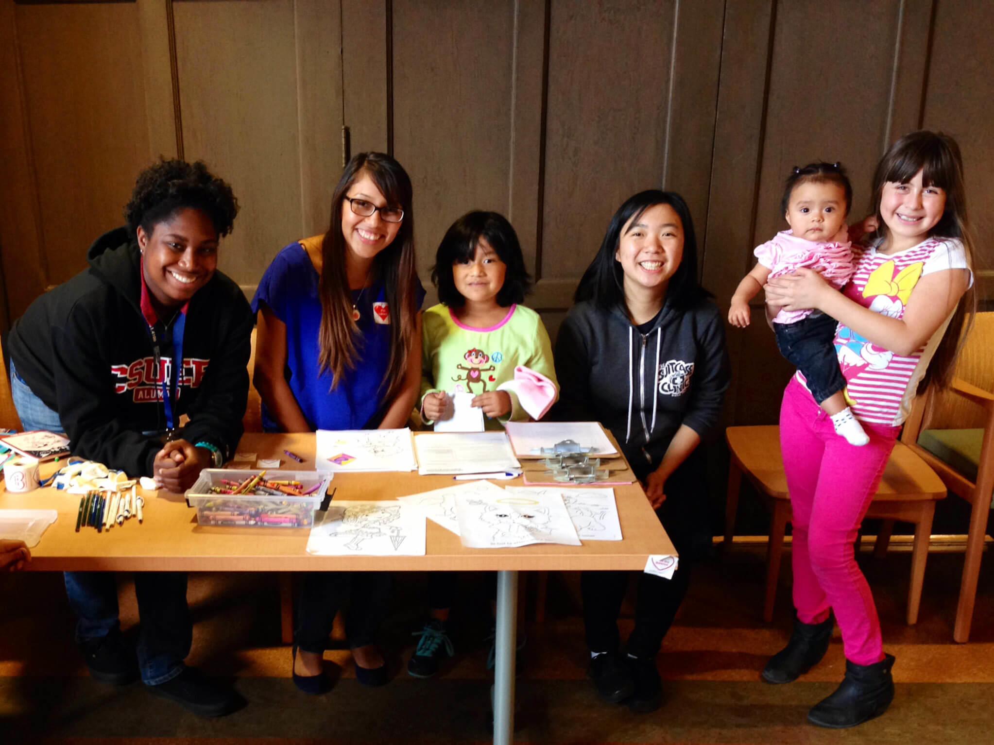 Volunteers with group of children